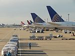 US Airline line-up at NRT (16163404323).jpg