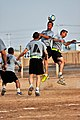 US Army 52941 CAMP TAJI, Iraq-Showing his aerial ability, Spc. Cory Silva (center), from Pawtucket, R.I., , 3rd Battalion, 227th Aviation Regiment, beats others to the ball during a scrimmage game, Oct.10.jpg