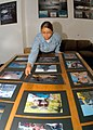 US Navy 030926-N-5134H-002 Photographer's Mate 3rd Class Elizabeth Acosta assigned to Fleet Imaging Center Pacific, looks at her fellow photographer's entries.jpg