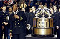 US Navy 040130-N-9693M-014 U.S. Naval Academy football team co-captain Eddie Carthan addresses the crowd next to the Commander-in-Chief's trophy.jpg