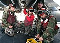 US Navy 040629-N-8654O-021 Aviation Ordnanceman perform a stray voltage check to a BRU-32 Bomb Release Unit.jpg