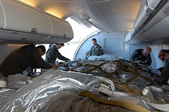 Boeing C-40 Clipper - C-40A transporting palletized humanitarian cargo, 2005.