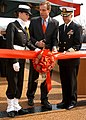 US Navy 050319-N-1161S-032 Gov. Mark Warner (D-VA), Capt. Phillip Beierl, Storekeeper Seaman Linsay Henry cut the ribbon at a dedication ceremony.jpg