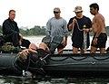 US Navy 050816-N-1722M-304 Diver Lt.j.g. Kevin Grant, assigned to Explosive Ordnance Mobile Unit Twelve (EODMU-12), Detachment 10, enters the water to test the recently deployed Cerebus Swimmer Detection System.jpg