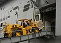 US Navy 051021-N-3527B-064 A crew member moves supplies up the ramp of the amphibious assault ship USS Wasp (LHD 1).jpg