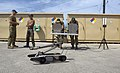 US Navy 060419-N-9167V-424 U.S. and Royal Australia military personnel demonstrate a Pack Robot at the Explosive Ordnance Disposal Mobile Unit Five (EODMU-5) compound on board Naval Base Guam.jpg
