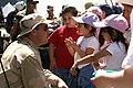 US Navy 060506-N-5324D-008 - Denver citizens and Cinco de Mayo Celebrate Culture festival participants, talk with Equipment Operator 2nd Class Gregory Moreno assigned to the West Coast Explosive Ordnance Disposal Mobile Unit On.jpg