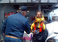 US Navy 060522-N-0170L-001 The Commanding Officer of the guided-missile cruiser USS Vella Gulf (CG 72), Capt. Steve Davis welcomes Mr. Johan Aarden safely aboard.jpg