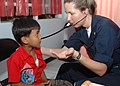 US Navy 060821-N-3931M-092 Navy Lt. Cmdr. Elizabeth Ferrara with the Medical Treatment Facility aboard the Military Sealift Command hospital ship USNS Mercy (T-AH 19) examines the breathing of a young boy.jpg