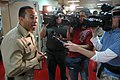 US Navy 070617-N-0194K-293 Casualty and Receiving Division Officer Lt. Cmdr. Manny Santiago addresses Miami media aboard Military Sealift Command hospital ship USNS Comfort (T-AH 20).jpg