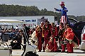 US Navy 070909-N-6676S-773 The British Red Devils Jump Team poses for photos with Steve Myott, Uncle Sam on Stilts, after a jump during the 2007 Naval Air Station Oceana Air Show.jpg