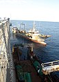 US Navy 071105-N-0000X-008 Manuvo II gets underway after receiving fuel and stores for transit back to the next port.jpg