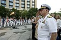 US Navy 080701-N-8273J-087 Chief of Naval Operations (CNO) Adm. Gary Roughead renders honors as Sailors assigned to the Navy Ceremonial Guard present the colors at the Navy District Washington Concert on the Avenue at the U.S.jpg