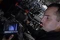 US Navy 080831-N-7730P-082 Aviation Machinist's Mate 2nd Class Cameron Prince uses a borescope to inspect foreign object damage to the engine of an F-A-18E Super Hornet.jpg