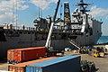 US Navy 100202-N-7918H-148 The amphibious dock-landing ship USS Ashland (LSD 48) takes on humanitarian supplies at Naval Station Guantanamo Bay.jpg