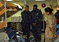 US Navy 100217-N-1092P-080 Rear Adm. Victor G. Guillory, commander, U.S. Naval Forces Southern Command, speaks with Haitian patients receiving medical care aboard the Military Sealift Command hospital ship USNS Comfort (T-AH 2.jpg