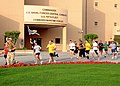 US Navy 100401-N-0311M-013 Navy Chiefs, Sailors and civilians from Naval Support Activity Bahrain and its tenant commands run by the U.S. Naval Forces Central Command building during a Run with the Chiefs to celebrate the Chief.jpg