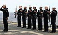 US Navy 100407-N-8729S-001 Sailors aboard the guided-missile frigate USS Klakring (FFG 42) render honors during a burial at sea.jpg