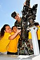 US Navy 100413-N-8433N-995 Gunner's Mate 3rd Class Brian Balch demonstrates to students how a M2HB 50-caliber machine gun works aboard a patrol boat during career day at Astumbo Elementary School.jpg