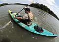US Navy 100714-N-4267W-093 Michael Albritton navigates a kayak during a confidence building evolution at Camp Trident summer camp.jpg