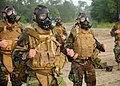 US Navy 100806-N-9564W-089 Seabees run in place in full mission oriented protective posture (MOPP) gear and gas masks during a battalion readiness exercise at Naval Construction Battalion Center, Gulfport.jpg