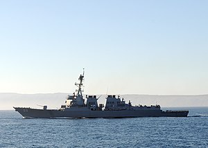 US Navy 101101-N-1004S-002 The Arleigh Burke-class guided-missile destroyer USS Preble (DDG 88) provides protection for the aircraft carrier USS Ro.jpg
