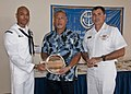 US Navy 110408-N-AZ907-009 Hospital Corpsman 1st Class Tracy Ashley accepts a silver plate honoring him as a Guam service members of the year.jpg