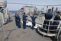 US Navy 110409-N-RC734-091 Sailors stand watch on the port bridge wing aboard the amphibious dock landing ship USS Comstock (LSD 45) during an unde.jpg