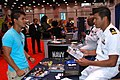 US Navy 110630-N-MN593-014 Lt. Jason Bailey, assigned to Navy Recruiting District Ohio, discusses opportunities available in the Navy during the Le.jpg