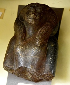 Twelfth Dynasty of Egypt - Upper part of a statuette of an unidentified queen. The nose was deliberately battered. Black granite. Early 12th Dynasty. From Egypt. The Petrie Museum of Egyptian Archaeology, London