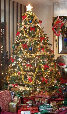 a christmas tree inside a home - Christmas Tree With Lights And Decorations
