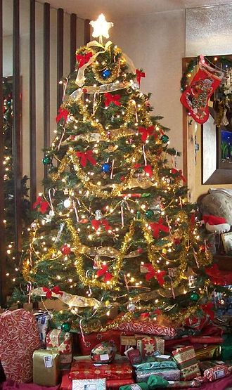 Christmas music - A Christmas tree inside a home