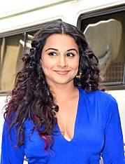Vidya Balan is smiling away from the camera