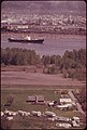 View Across the Columbia River to Heavily Industrialized Longview. In Foreground Is a Farm and Trailer Camp near Rainier Oregon 04-1973 (4272346790).jpg
