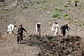 Villagers search for scrap metal after a controlled detonation at the demolition range at Forward Operating Base Salerno in Khost province, Afghanistan, Sept 120902-A-PO167-137.jpg