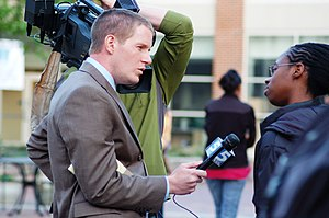 English: WRAL-TV reporter Adam Owens in Chapel...