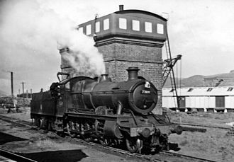 Welshpool railway station - G.J. Churchward designed GWR 4300 Class 2-6-0 No. 7309 exits the locomotive depot at Welshpool in 1957
