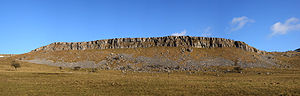 Yorkshire Dales - Cliffs of Carboniferous Limestone are a common geological feature in the Yorkshire Dales; this panoramic image shows the western face of Thwaites Scars taken from Long Lane.