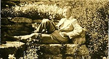 Arnold-Forster reclining in a garden in Italy around 1911
