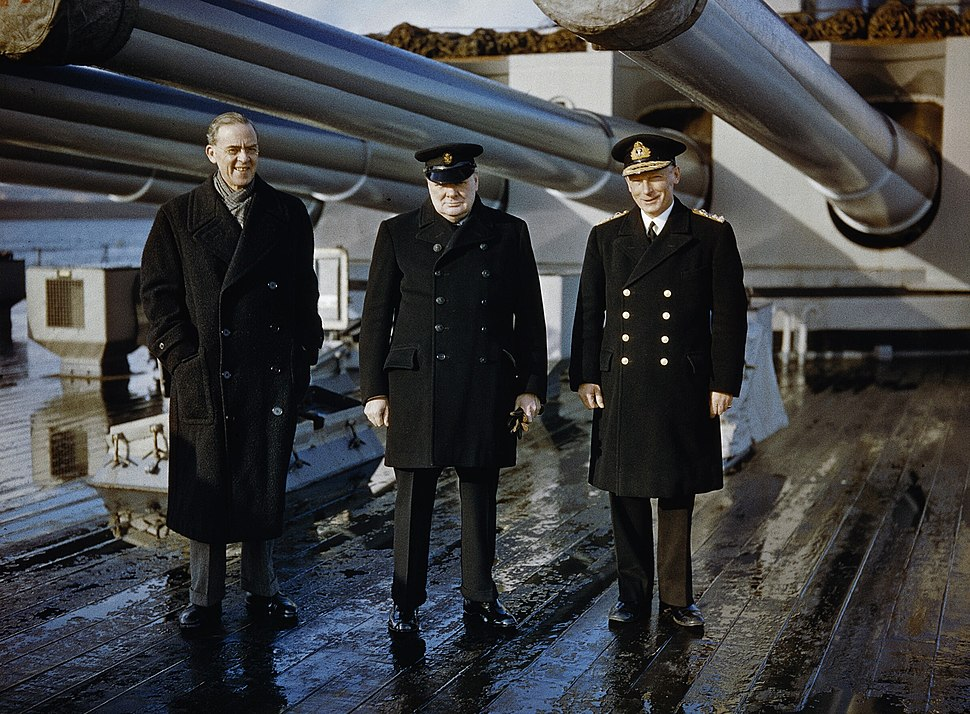 Winston Churchill with the Lord Privy Seal, Sir Stafford Cripps, and the Commander-in-Chief Home Fleet, Admiral Sir John Tovey, on the quarterdeck of HMS KING GEORGE V at Scapa Flow, 11 October 1942. TR210