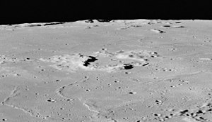 Wolf (crater) - Oblique view of Wolf from Apollo 16, facing south