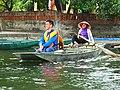 Woman rowing sampan with her feet in Ninh Bình Province of northern Vietnam.jpg