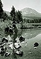 Woman wearing swimsuit standing at the edge of Manzanita Lake, gazing up at the sky, with Mt. Lassen in the background, Lassen (c0c26296d9c844d392b9c8a44c099181).jpg