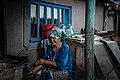 Woman weaves wickerwork.jpg