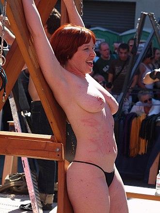 Sadomasochism - Bound woman whipped at Folsom Street Fair, USA, 2010