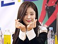 Year 7 Class 1 member with finger hearts in 2015.jpg