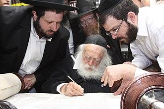 Inauguration of a Torah scroll - Rabbi Chaim Kanievsky writes the final letters in a new Torah scroll, 2014