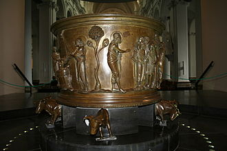 Baptismal font at St Bartholomew's Church, Liège - Saint John the Baptist preaching, the start of the sequence of scenes