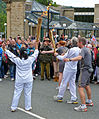 2012 torch relay day 37 The handing-over of the flame (7433157388).jpg