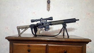 .300 AAC Blackout - AR-15 rifle with dustcover and magazine band that identify it as having a chambering of .300 AAC Blackout